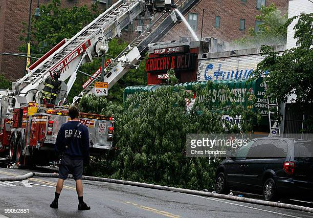 A firefighter watches as the remainders of a threealarm fire are estinguished that broke out at 502 East 14th Street across from Stuyvesant Town in...