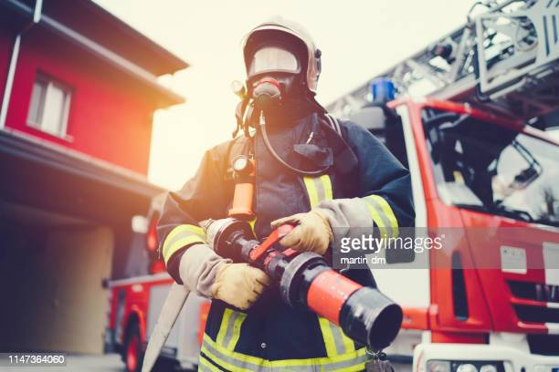 firefighter wearing oxygen mask - rescue worker stock pictures, royalty-free photos & images