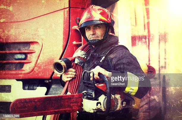 Firefighter with chainsaw and fire hose in the Wings