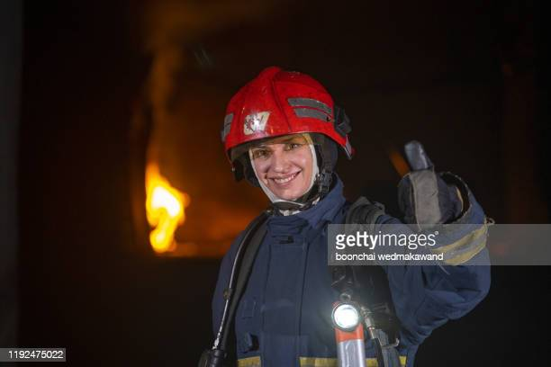 firefighter with work helmet looking at camera - rescue worker stock pictures, royalty-free photos & images