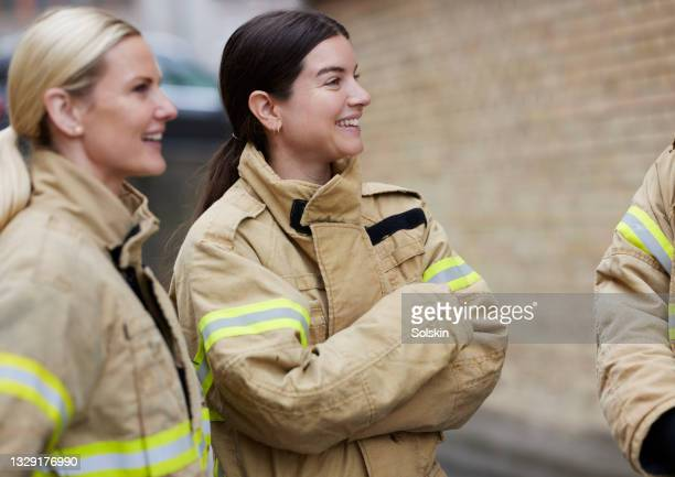 firefighter women - health and safety stock pictures, royalty-free photos & images