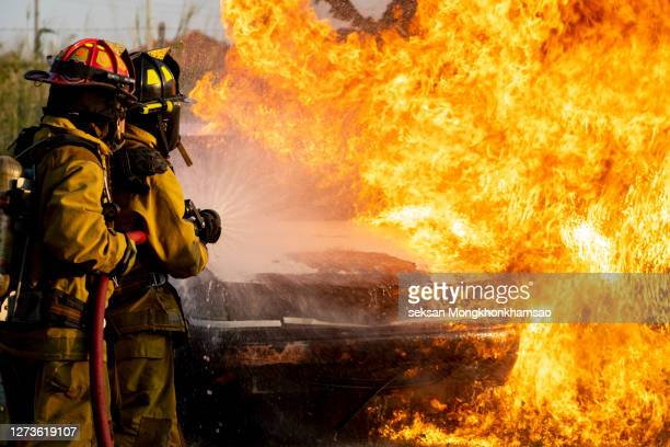 firefighter work at night. - fire protection suit stock pictures, royalty-free photos & images