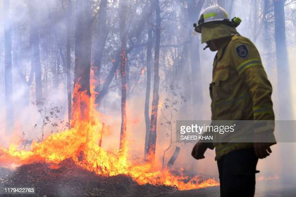 A firefighter works as a bushfire believed to have been sparked by a lightning strike that has ravaged an area of over 2000 hectares in northern New...