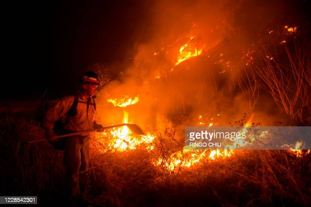 Firefighter works at the scene of the Bobcat Fire burning on hillsides near Monrovia Canyon Park in Monrovia, California on September 15, 2020. - A...