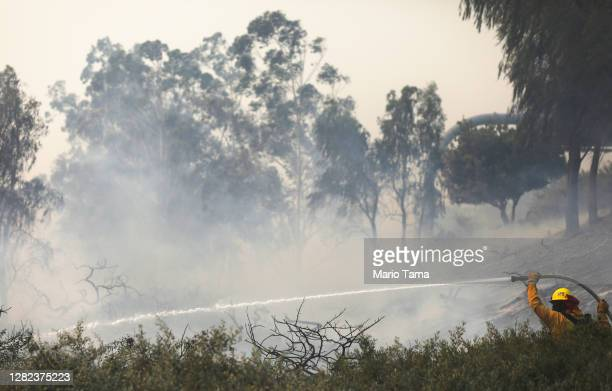 Firefighter works during the Silverado Fire in Orange County on October 26, 2020 in Irvine, California. The fire has prompted mandatory evacuations...