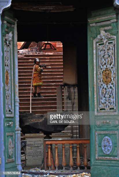 A firefighter works near a meteorite at Rio de Janeiro's treasured National Museum one of Brazil's oldest on September 3 a day after a massive fire...