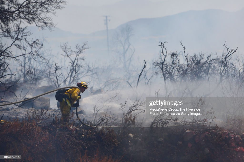 A firefighter works the Keenbrook Fire in the Cajon Pass on    News