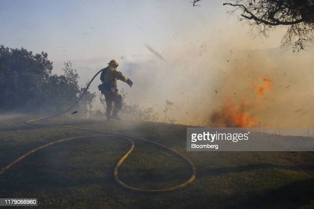 A firefighter works to protect the Ronald Reagan Presidential Library during the Easy Fire in Simi Valley California US on Wednesday Oct 30 2019...