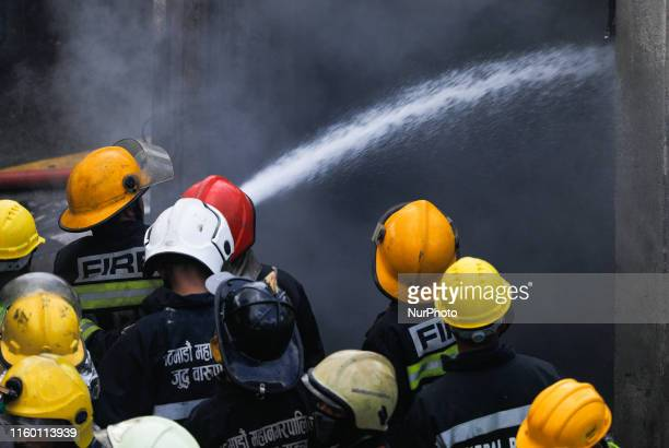 Firefighters along with Army and Police work to put out a fire at Subisu Cablenet Pvt Ltd located in Baluwatar Kathmandu on Wednesday August 7 2019...