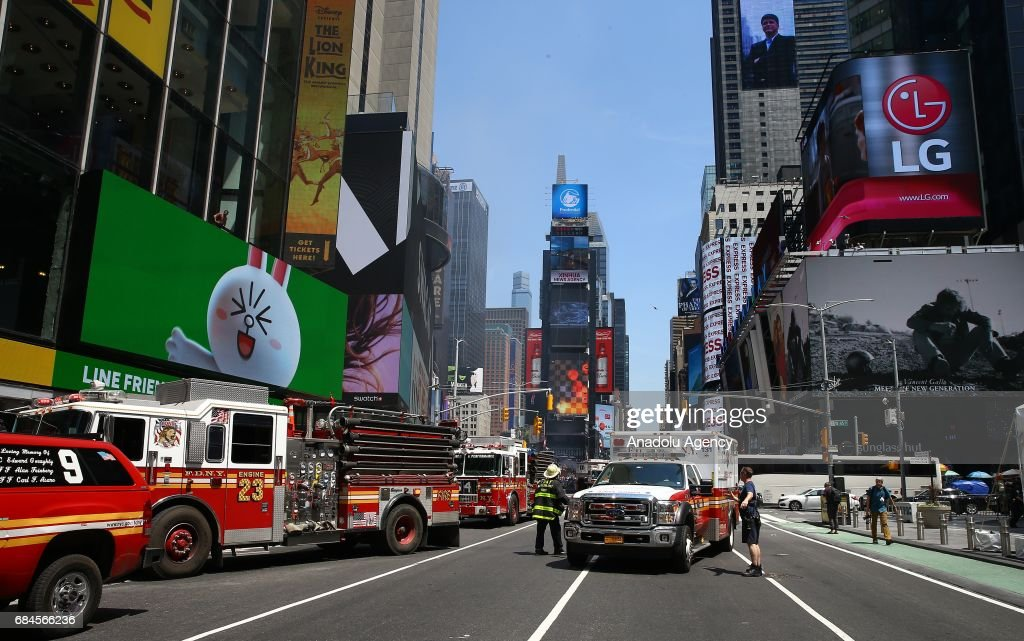 Firefighters and ambulances arrive at the incident scene after a maroon sedan car plowed into pedestrians on a busy sidewalk on the corner of West 45th St. and Broadway at Times Square, New York, NY United States on May 18, 2017. Multiple pedestrians were struck Thursday by a speeding vehicle in the heart of New York City, according to reports. At least 1 people dead and 19 others wounded.