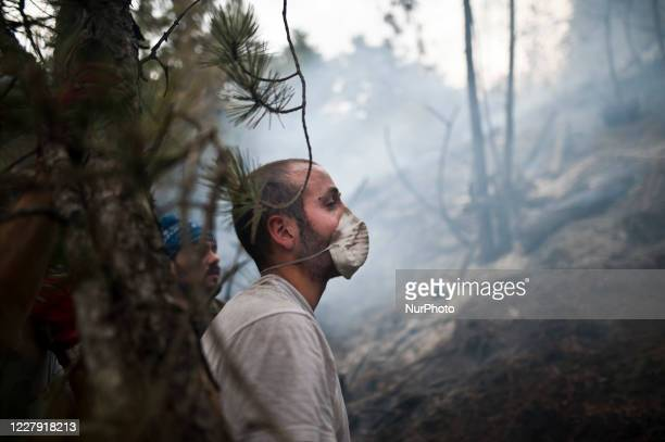 Firefighters and Civil Defense men at work to control fires in the mountains near L'Aquila August 4 2020 Fifth day of fear and concern about the fire...