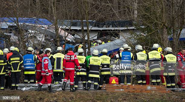Firefighters and emergency doctors work at the site of a train accident near Bad Aibling southern Germany on February 9 2016 Two Meridian commuter...