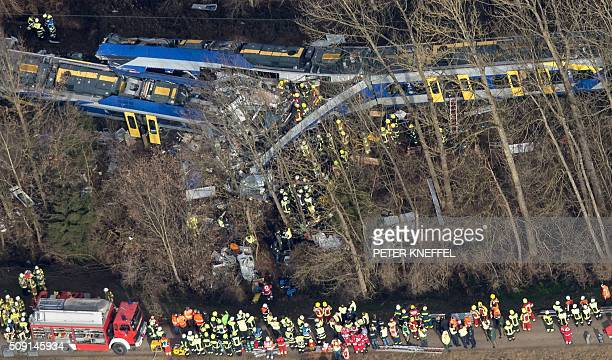 CROP Firefighters and emergency doctors work at the site of a train accident near Bad Aibling southern Germany on February 9 2016 Two Meridian...