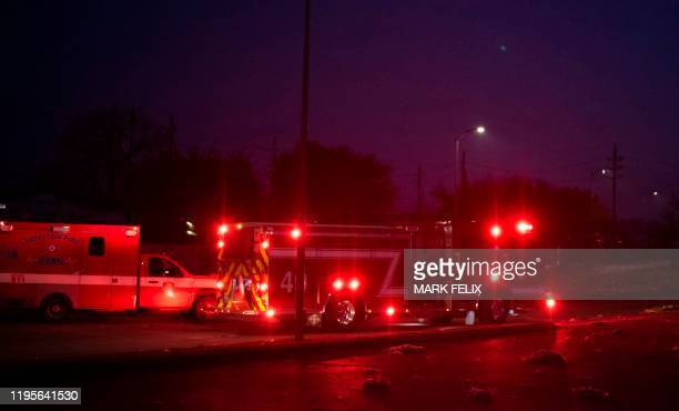 Firefighters and emergency services arrive at a scne of a reported explosion in Houston, Texas, on January 24, 2020. - A large explosion shook the US...