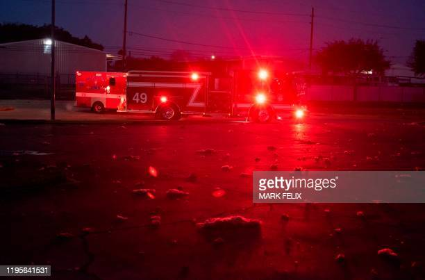 TOPSHOT Firefighters and emergency services arrive at a scne of a reported explosion in Houston Texas on January 24 2020 A large explosion shook the...