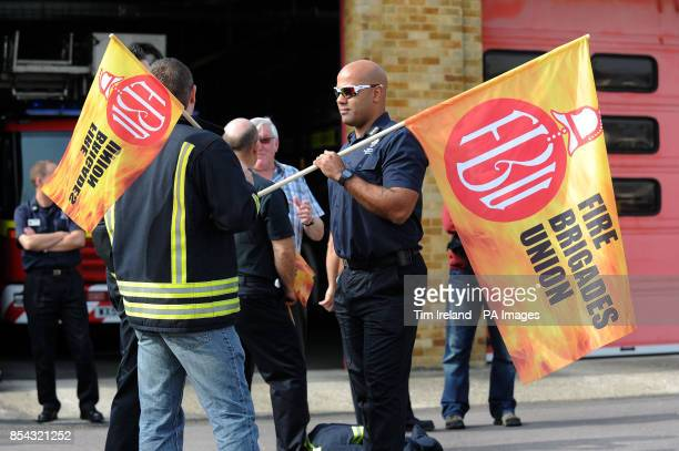 Firefighters and Fire Service staff from Wiltshire gather on the picket line outside Drove Road fire station in Swindon Wiltshire as firefighters...