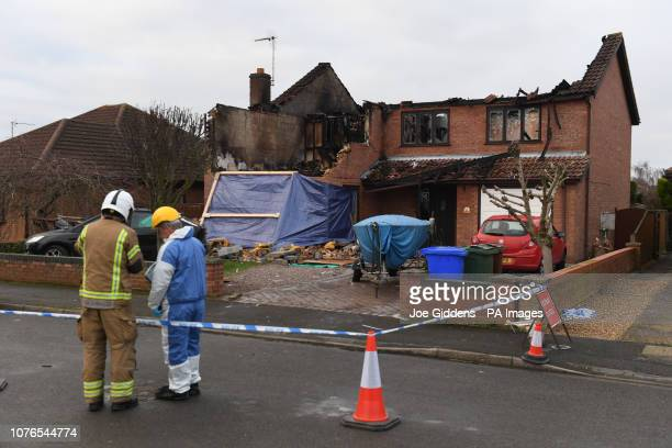 Firefighters and investigators at the scene after a house fire in Peartree Road Kirton near Boston in Lincolnshire where police have launched a...