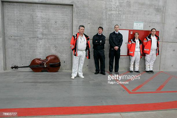 Firefighters and medics standing beside a bass attend the inauguration ceremony of the Airbus A380 hangar at Frankfurt airport are checked January 11...