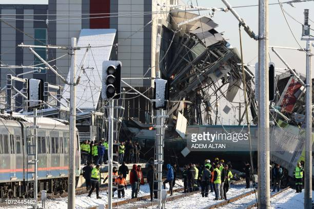 TOPSHOT Firefighters and medics try to rescue victims after a highspeed train crashed into a locomotive in Ankara on December 13 2018 Nine people...