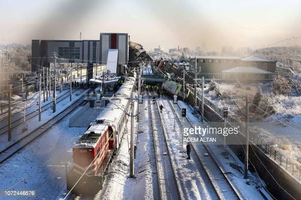 Firefighters and medics try to rescue victims after a highspeed train crashed into a locomotive in Ankara on December 13 2018 Nine people were killed...