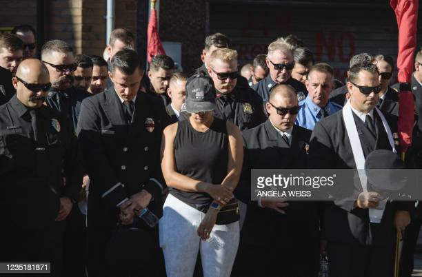Firefighters and others take part in a moment of silence on the 20th anniversary of the 9/11 attacks on the World Trade Center in New York, on...