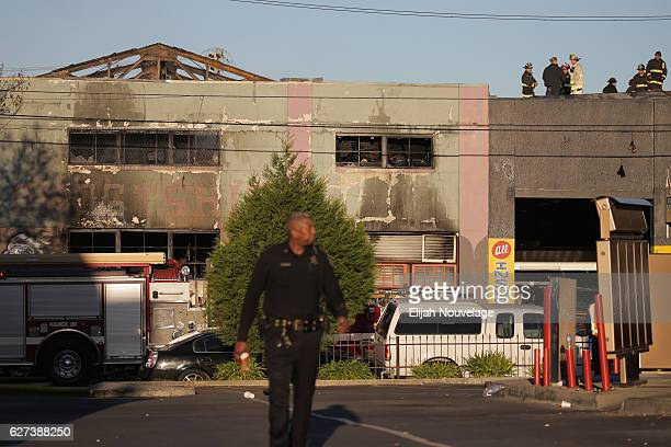 Firefighters and police at the scene of a overnight fire that claimed the lives of at least nine people at a warehouse in the Fruitvale neighborhood...