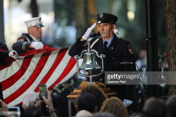 Firefighters and police participate in the start of ceremonies at the National September 11 Memorial on September 11 2019 in New York City Throughout...