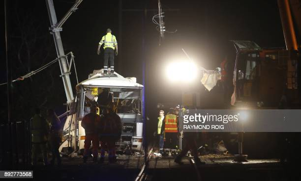 TOPSHOT Firefighters and police work at the site of an accident in Millas near Perpignan southern France on December 14 after a train crashed into a...