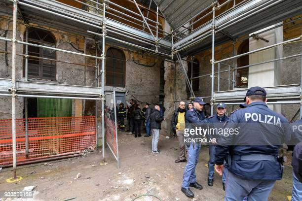 Firefighters and police work in the site of a collapsed wall inside the abandoned monastery of the church of San Giovanni Maggiore in downtown Naples...