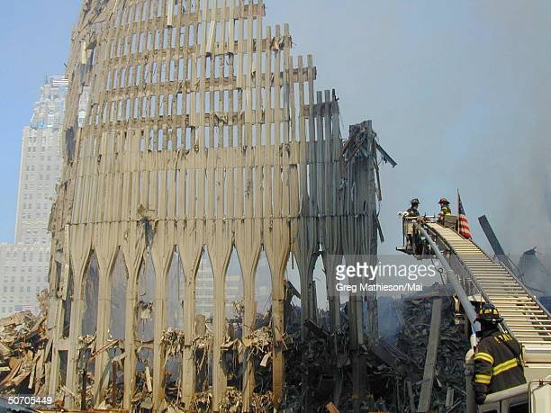 Firefighters and urban rescue workers siftting through the rubble of the World Trade Center searching for survivors after a terrorist attack...