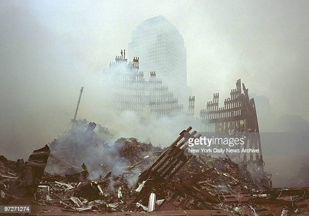 Firefighters and volunteers from all over the United States clear debris as rescue operations proceed at World Trade Center terrorist attack site..