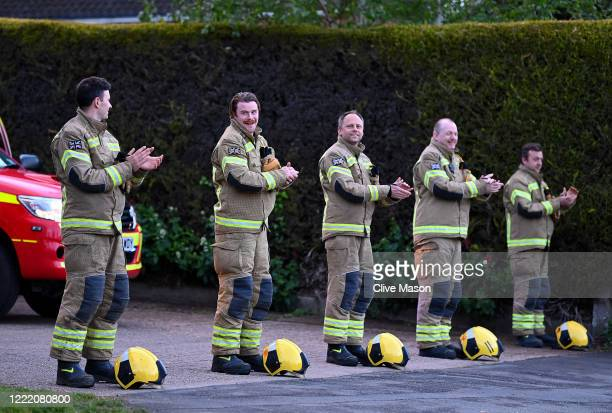Firefighters applaud during the weekly Clap For Carers on April 30 2020 in Brixworth United Kingdom Following the success of the Clap for Our Carers...