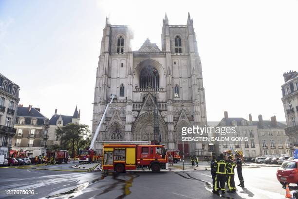 Firefighters are at work to put out a fire at the Saint-Pierre-et-Saint-Paul cathedral in Nantes, western France, on July 18, 2020. - The major fire...