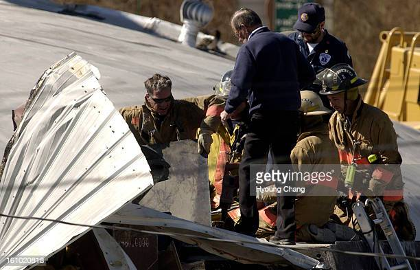 GRANBY CO JUNE 5 2004 Firefighters are making a hole on top of the Bulldozer to bring out Marvin Heemeyer's body at Gambles store on Saturday morning