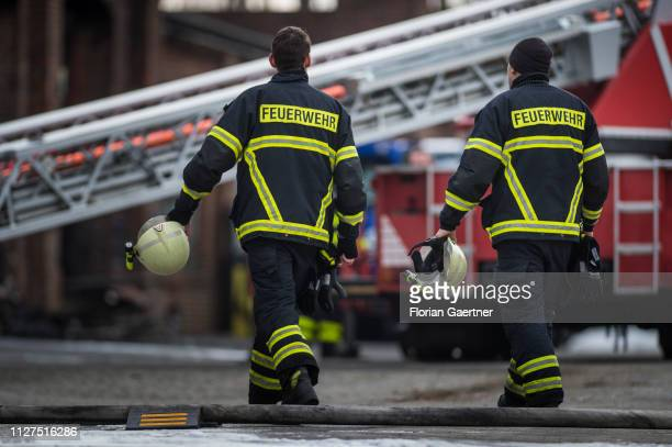 Firefighters are pictured the day after a big fire at an industrial hall on February 26, 2019 in Goerlitz, Germany.