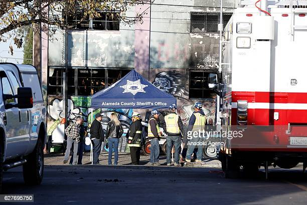 Firefighters are seen after a blaze gutted a warehouse in Oakland California on December 4 2016 Twentyfour people lost their lives The early Saturday...
