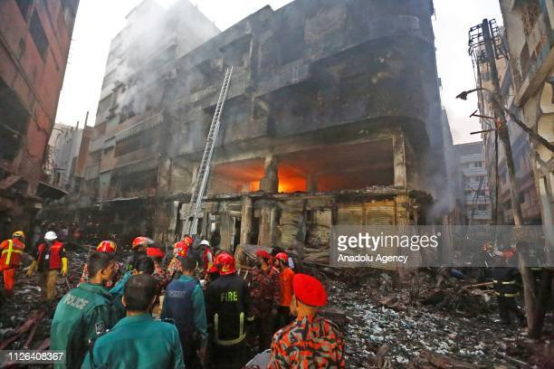 Firefighters are seen at the scene of a fire in Dhaka on February 21 2019 At least 70 people were killed on February 20 2019 when a massive fire...