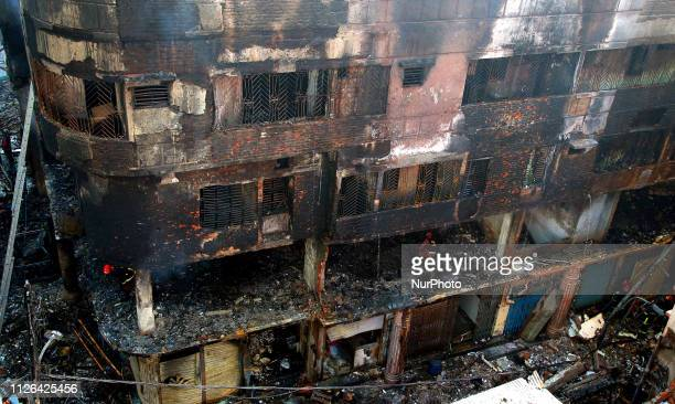 Firefighters are seen at the scene of a fire in Dhaka on February 21 2019 At least 69 people have died in a huge blaze that tore through apartment...