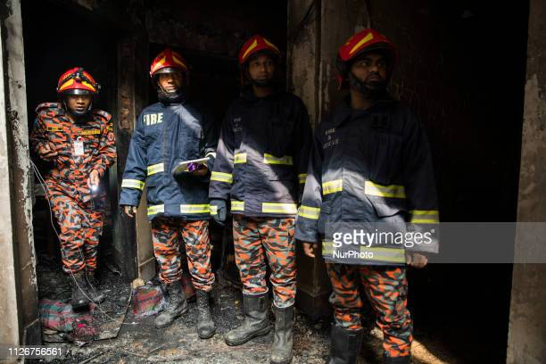 Firefighters are seen at the scene of a fire in Dhaka on February 22 2019 At least 81 people have died in a huge blaze that tore through apartment...