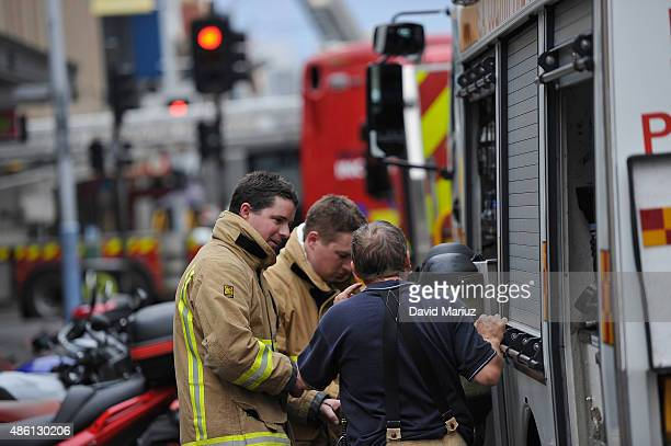 Firefighters are seen attending a blaze on September 1 2015 in Adelaide Australia People have been evacuated from nearby buildings as 75 firefighters...