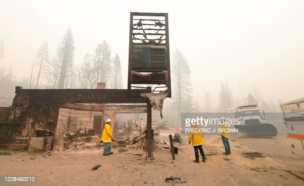 Firefighters are seen on scene at Cressman's, a landmark Shaver Lake general store and gas station since 1904 where only the sign remains standing...