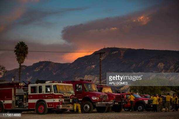 Firefighters are taking a break at the end of the day in front of the scorched mountain after the Maria Fire in Santa Paula Ventura County California...