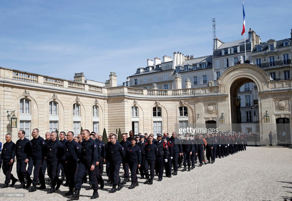 FRA: French President Emmanuel Macron Receives Firefighters At Elysee Palace In Paris