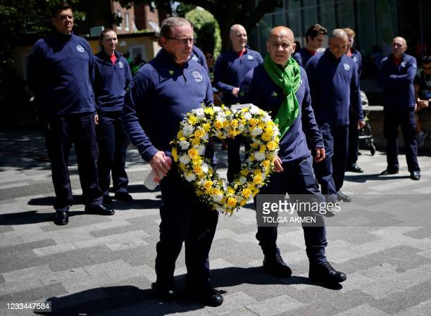 Firefighters arrive to pay their respects at a memorial to the victims of the Grenfell Tower fire, in west London on June 14 four years after the...