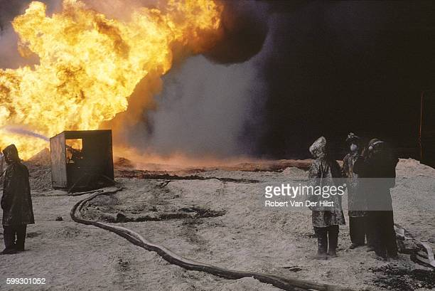 Firefighters at a burning oil well in Kuwait. May 1991