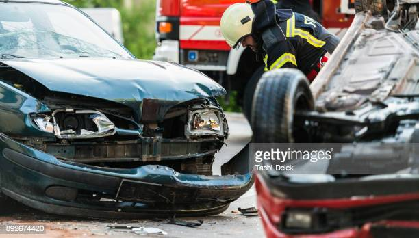 firefighters at a car accident scene - personal injury stock photos and pictures