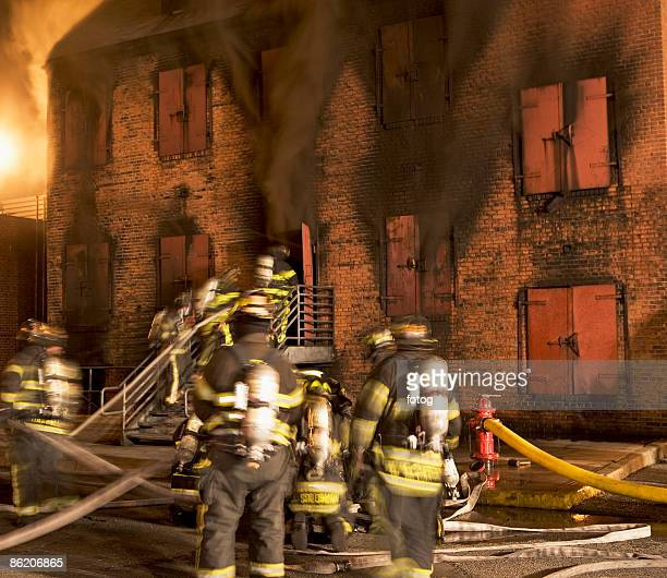 Firefighters at burning building