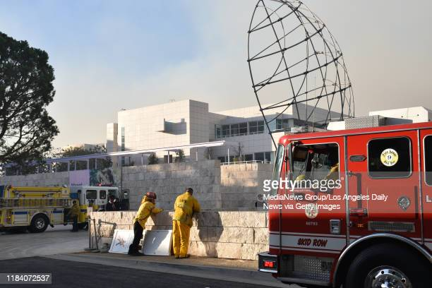 Firefighters at the Getty Museum using it as a staging area to approach the steep terrain around the landmark site during the Getty fire in Los...