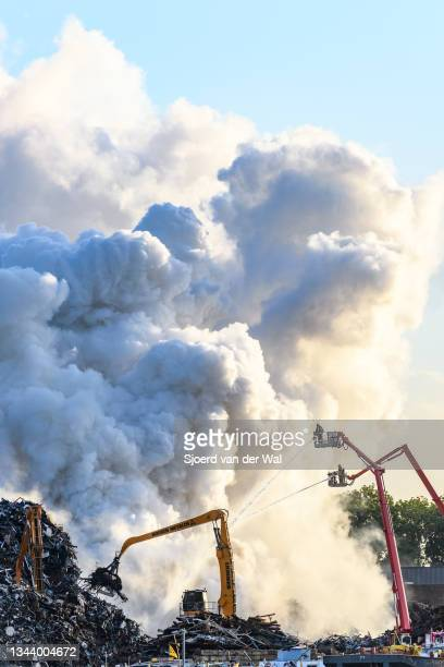 Firefighters at the scene of a fire at the Houben metal scrapyard on September 30, 2021 in Kampen, The Netherlands.