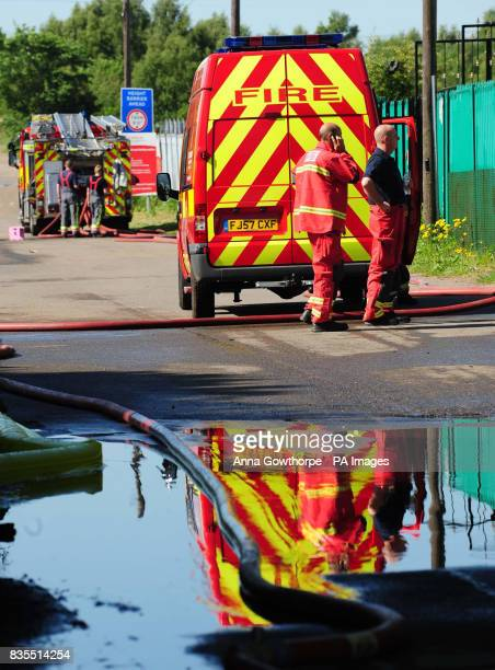 Firefighters at the scene of a fire at the Warsop Rubber Company factory in Market Warsop near Mansfield as an estimated 400000 tyres burn